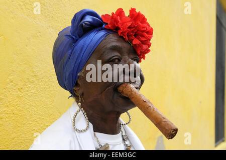 Woman with a cigar, Havana, Ciudad de La Habana, Cuba - Stock Photo
