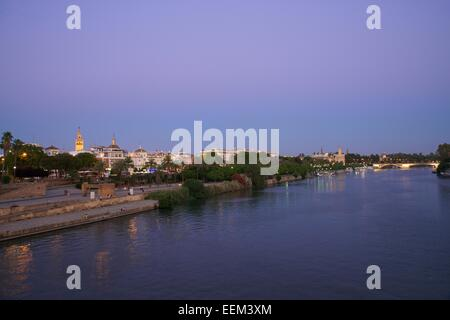 View over the Guadalquivir to the bullring and the cathedral, Seville, Andalucía, Spain - Stock Photo