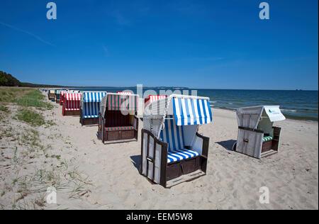 Roofed wicker beach chairs on the beach, Baltic Sea, Thiessow, Rügen, Mecklenburg-Western Pomerania, Germany - Stock Photo