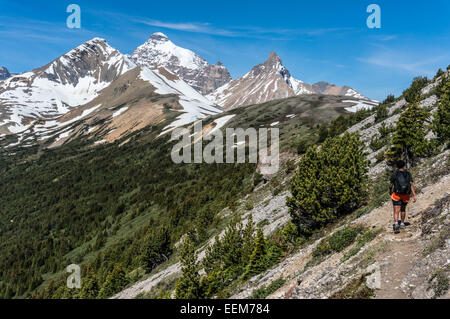 Canada, Alberta, Banff National Park, Canadian Rockies, Hiker walking along mountain - Stock Photo