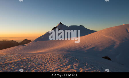 Switzerland, Allalinhorn, The Alps, Wallis, View of snowcapped mountains at sunrise - Stock Photo
