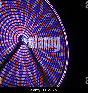 Night photograph of a ferris wheel in motion - Stock Photo