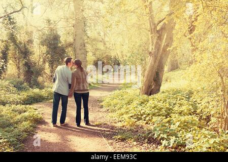 Lovers walking in the park - Stock Photo