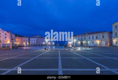Buildings and town square illuminated at night, Piran, Coastal-Karst, Slovenia - Stock Photo