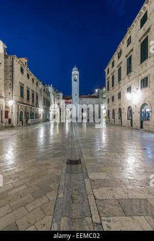 Town square, buildings and tower illuminated at night, Dubrovnik, Dubrovnik-Neretva, Croatia - Stock Photo