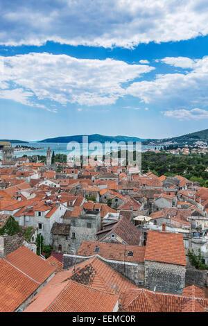 Aerial view of coastal city rooftops under cloudy sky, Trogir, Split, Croatia - Stock Photo