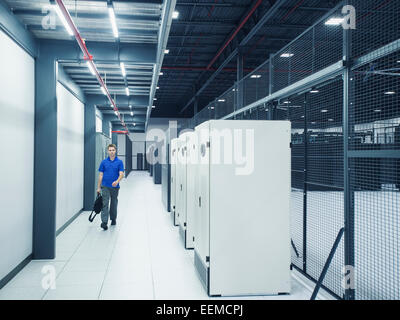 Caucasian businessman walking in server room