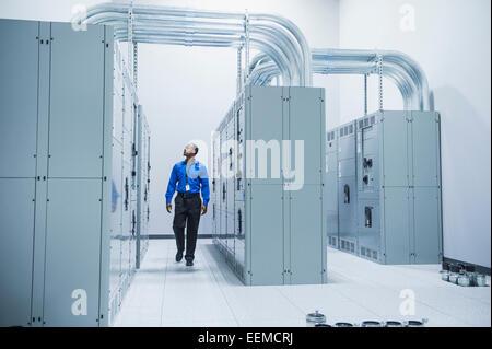 Black businessman walking in server room