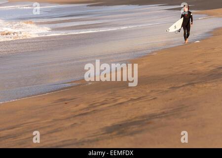 Surfer in beach. Donostia. San Sebastian. Euskadi. Basque country. Spain. Europe - Stock Photo