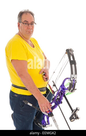 Guy with yellow shirt and jeans standing with a longbow - Stock Photo