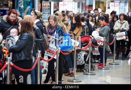 Shoppers queue for the opening of a new H&M store in the Clarendon Centre, Oxford - Stock Photo