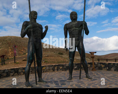 Bronze statues of ancient kings Guise and Ayose at Mirador Morro Velosa Viewpoint Fuerteventura Canary Islands popular - Stock Photo