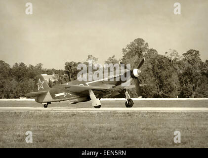 World War II era Soviet fighter plane on the ground - Stock Photo