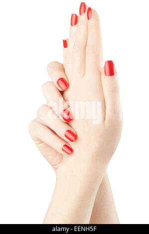 Manicure on female hands with red nail polish - Stock Photo
