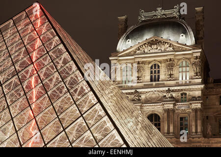 Louvre pyramid and museum night view in Paris, France - Stock Photo