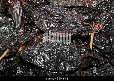 Ancho Chili Peppers - the dried version of Poblano, or 'people' peppers that smell like Raisins - Stock Photo