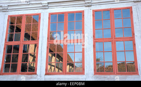Three Windows in an old half-timbered house in The Old Town, Aarhus, denmark - Stock Photo