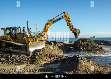 Poole Beach Replenishment 2014.  Sand pumping operation along Poole's Sandbanks Seafront. - Stock Photo