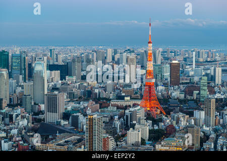 Tokyo Tower stands out among the Tokyo cityscape as evening approaches. - Stock Photo