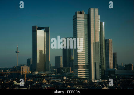Skyline of Frankfurt am Main's financial district looms above the town - Stock Photo