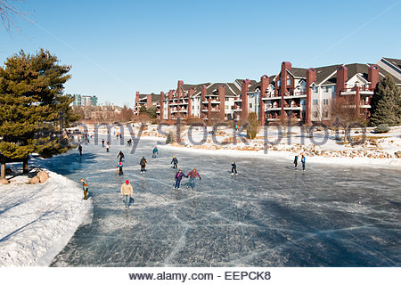 Winter fun on an outdoor ice-skating rink, Minnesota, USA - Stock Photo