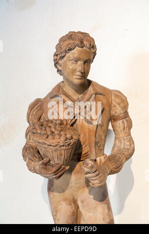Statue exhibit in the Colonial Art Museum (Museo del Arte Colonial) in Cathedral Square, Havana, Cuba - Stock Photo