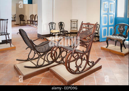 Room with antique wooden rocking chairs in the Colonial Art Museum (Museo del Arte Colonial) in Cathedral Square, - Stock Photo