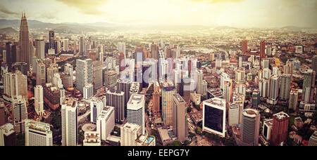 Retro filtered skyline of Kuala Lumpur, Malaysia. - Stock Photo