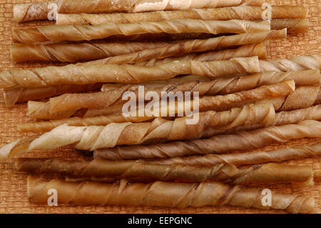 Assortment of rawhide chews for dogs. - Stock Photo