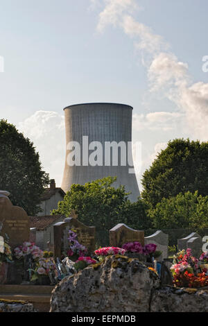 Cooling Tower of a Nuclear Power station overlooking the cemetery at Civaux. - Stock Photo