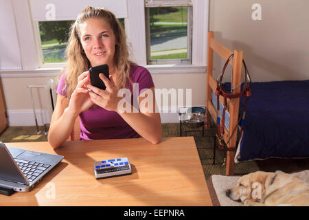 ... Student With Visual Impairment Using Her Cell Phone In Her Dorm Room    Stock Photo Part 34