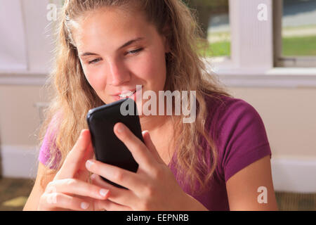 Student With Visual Impairment Using Her Cell Phone In Her Dorm Room    Stock Photo Part 53