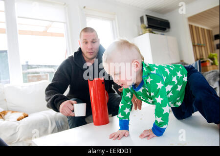 swedish father staying home with 1,5 year old son, paternity leave - Stock Photo