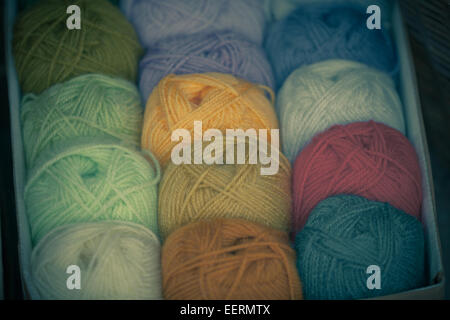 Colorful different wool thread balls in a box. Shot with shallow depth of field - Stock Photo