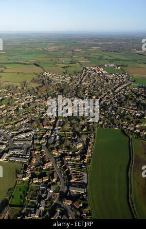 An aerial view showing the Somerset village of South Petherton in context with the surrounding rural landscape - Stock Photo
