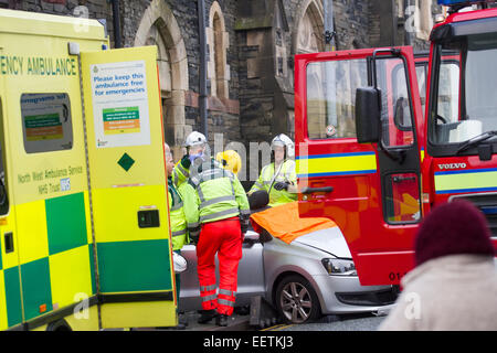 Bowness on Windermere Cumbria UK 21st January 2015. Car crashed into shop .Elderly woman has to be cut out of car - Stock Photo