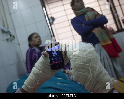 Dhaka, Bangladesh. 21st Jan, 2015. Prithiraj Chakraborti 22 suffering burn injuries from an attack on a bus during - Stock Photo