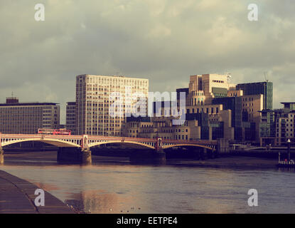 Vauxhall Bridge with secret intelligence service or MI6 building on the South Bank London England Europe - Stock Photo
