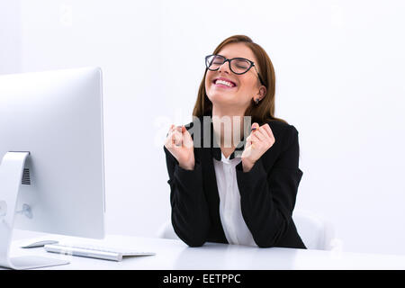 Successful business woman sitting at her workplace in office - Stock Photo