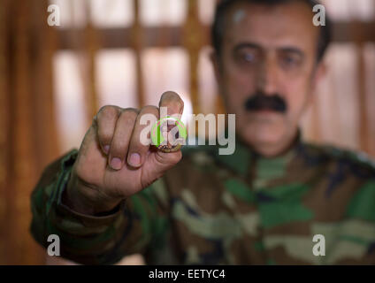 Yousuf Majid With A Badge Of His Dead Daughter Captain Rangin Yousuf Killed By Daesh, Sulaymaniyah, Kurdistan, Iraq - Stock Photo