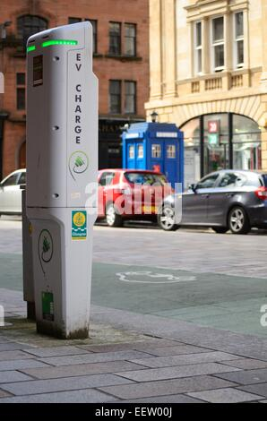 Electric vehicle charger in the Merchant City in Glasgow Scotland - Stock Photo