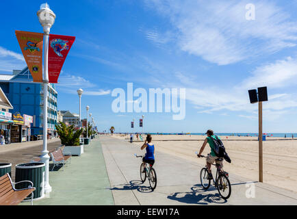 Cyclists on the boardwalk at Ocean City, Maryland, USA - Stock Photo