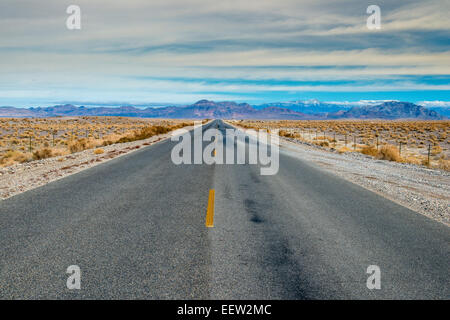 Deserted road, Death Valley National Park, California, USA - Stock Photo