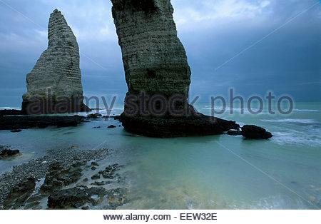 Etretat cliffs, the arch of Porte d'Aval and the aiguile d'Aval, pays de Caux, Seine-Maritime, France. Legend of - Stock Photo
