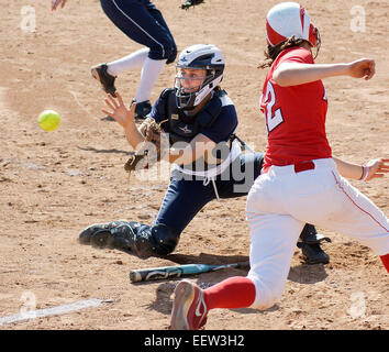 New Haven-- Yale catcher Sarah Onorato cant make the tag in time as Marist base runner, Alyssa Zahka slides in for a score during the second inning.