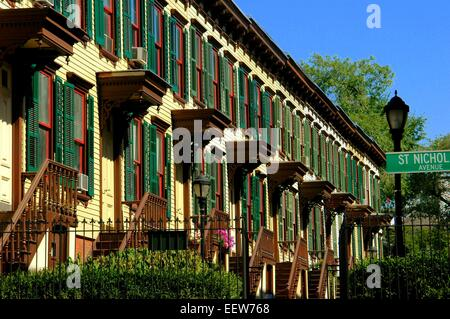 New York City:  Unique wooden row houses with stoops and covered doorways at historic Sylvan Terrace - Stock Photo