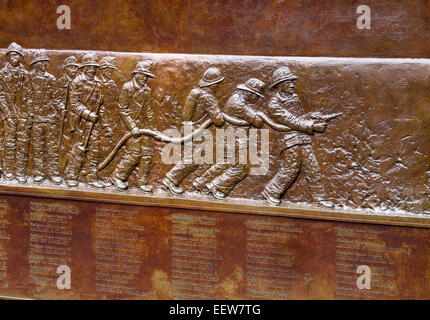 FDNY Memorial Wall detail. Detail from the bronze bas-relief sculpture which is a memorial bolted to the fire station - Stock Photo