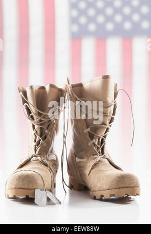 Military boots with dog tags - Stock Photo