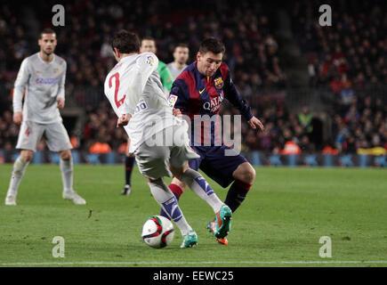 Barcelona, Spain. 21st Jan, 2015. Coppa del Rey quarterfinal 1st leg. Barcelona versus Atletico Madrid. Messi challenged - Stock Photo