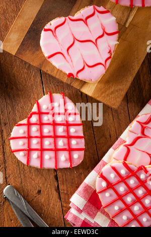 Homemade Pink Valentine's Day Cookies Shaped Like a Heart - Stock Photo